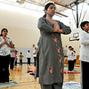 "SUN<br /> Left to right, Suma Patil, Nidhi Arya and Sudarshan Pillai participate in a Sun Salutation ""marathon"" held Sunday at Louisville Middle School. The event takes place all over the country, with an estimated 7,000 participants performing a total of one million yoga salutations in two weeks.  <br /> Photo by Marty Caivano/Jan. 30, 2011"