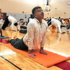 "SUN<br /> Ramesh Kamekal participates in a Sun Salutation ""marathon"" held Sunday at Louisville Middle School. The event takes place all over the country, with an estimated 7,000 participants performing a total of one million yoga salutations in two weeks.  <br /> Photo by Marty Caivano/Jan. 30, 2011"
