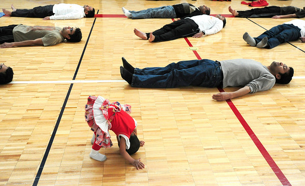 "SUN<br /> during a Sun Salutation ""marathon"" held Sunday at Louisville Middle School. The event takes place all over the country, with an estimated 7,000 participants performing a total of one million salutations in two weeks.  <br /> Photo by Marty Caivano/Jan. 30, 2011"