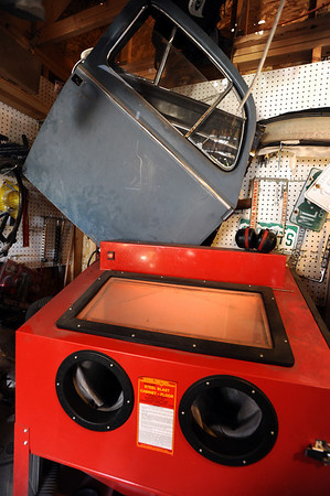 BARTVW<br /> Bart Dunn of Erie has a sandblasting machine he uses to restore parts for his vintage Volkswagens.<br /> Photo by Marty Caivano/Camera/Aug. 10, 2010
