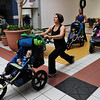 STROLLER<br /> Stephanie Elston, foreground, does walking lunges with her son Benjamin, 2, at a Stroller Strides workout in Longmont. At center is instructor Elaine Waterman with her son Ethan, 2; at right is Darci Crawford.<br /> Photo by Marty Caivano/Camera/Dec. 10, 2010