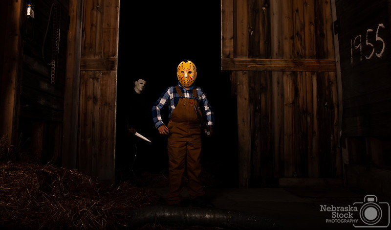 10-30-2018<br /> <br /> 303/365<br /> <br /> Michael Myers and Jason Voorhees were running loose last night in Pierce County. This is what happens when your dad is a big horror movie fan and loves Halloween, your son has followed in your footsteps, and you have some photography equipment in your office. <br /> <br /> Photo taken with a Nikon D600 with a Nikon 28-70<br /> <br /> Two flash boxes<br /> <br /> ISO 200<br /> <br /> 1/250th at F6.3<br /> <br /> Picture No. 191465