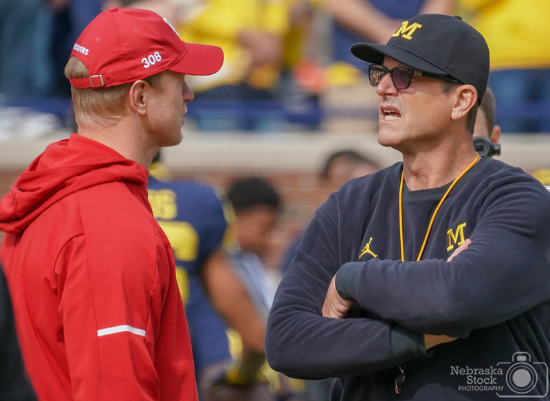 """9-22-2018<br /> 265/365<br /> Nebraska's head coach Scott Frost and Michigan's head coach Jim Harbaugh talk before the game Saturday morning at the """"Big House"""" in Ann Arbor, Mich. <br /> Photo taken with a Sony A9 with a Sony FE 100-400<br /> ISO 2000<br /> 1/1000th at F11<br /> Picture No. 163141"""