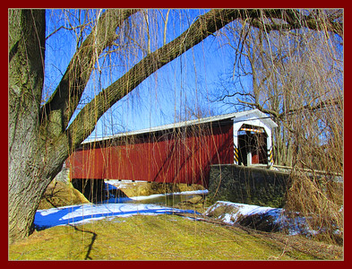 March 19, 2015  Lime Valley Covered Bridge  The Lime Valley Covered Bridge or Strasburg Bridge is a covered bridge that spans Pequea Creek in Lancaster County, Pennsylvania, United States.  A county-owned and maintained bridge, its official designation is the Pequea #8 Bridge.  The bridge has a single span, wooden, double Burr arch trusses design with the addition of steel hanger rods. The deck is made from oak planks. It is painted red, the traditional color of Lancaster County covered bridges, on both the inside and outside. Both approaches to the bridge are painted in the traditional white color.  Info via: http://en.wikipedia.org/wiki/Lime_Valley_Covered_Bridge