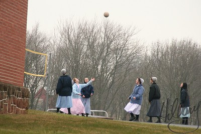 12/27/07 - We took time for a drive into Lancaster County, PA today. As we drove through the town of Ephrata, PA we saw this group of Mennonite girls playing volleyball behind a school. Glad I have a telephoto zoom on my camera. This was a shot from the street as I was not too sure how comfortable they would be for me to take their picture. I will post a few other shots from the drive in my travel gallery.