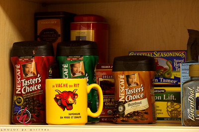 Post 340 11/21/08 Coffee or tea anyone?   We decided to switch coffee/tea/mug cabinet with the spice/flour/sugar cabinet. So, nice and fresh I figured that it was a good idea for my photo of the day including one of my favorite mugs, too.   Anyway, that's it! Never know what a little housecleaning will inspire...With so much time on the computer in recent months I have lots of housecleaning to catch up with!!! Have a good weekend everyone!