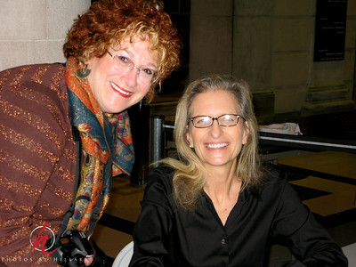 """Post 352 12/5/08  What a thrill!!! Annie Leibovitz and me!!!  Steve's photo of the day! He took this of me with Annie in Center City Philadelphia where we saw her speak at the 'Free Library'  She has a new book out called, """"Annie Leibovitz at Work"""" and details her shooting aobut 100 of her famous photos. It was just so cool to see a backdrop of her photos with her speaking....what an icon she is and sooooo warm and nice when I met her. Very patient to speak with everyone..I was thrilled! She signed my book that Steve and Sam got me for Mother's Day 2 years ago..really a special thrill for me!  I will be leaving for Washington DC for two days so I'll be back with photos by Sunday night. Have a great weekend!"""