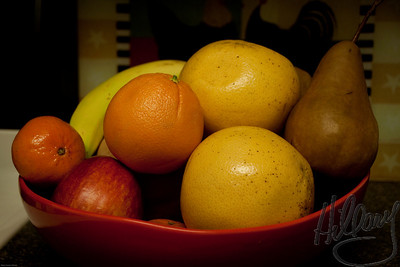 Post 642 12.20.09  ....Back to the kitchen studio!  I always like the light in my kitchen and since it was gray and snowy outside yesterday I took a couple shots of my fruit bowl once again. This is almost straight out of the camera. A slight increase in the black and a light vignette in Lightroom is all.  Happy Sunday to all of you....