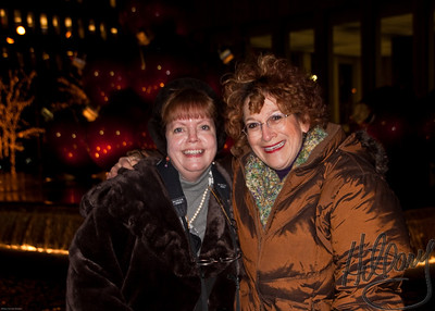 Post 641 (Post 3 of 3 today) 12.19.09 Yay...we got a SmugMug meet-up in before the big Snow today!  I was able to connect with Betsy Foster-Breen while she is in New York and this shot was taken by Steve of the two of us last night across the street from Radio City Music Hall. Can you believe she recognized me from behind because she saw my hair???? Yeah, I believe it, too!  What a fun hour Steve and I had chatting with Betsy and her good friend and travel buddy Jim. We warmed up in a little coffee shop and get a chance to talk 'shop' and get to know each other a little better!!! It was just great! I love meeting Smuggers!!!!  Stay bundled Betsy!!! Baby, it's cold outside..!~