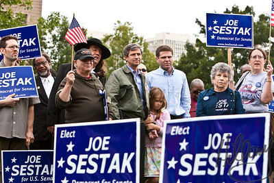 "Post 735 10.5.10  A shot from Sunday's rally for Congressman Sestak. I am so often cropping in tight and though I love really getting in close I sometimes miss the message of the scene. This was a fun shot of Admiral Sestak standing on the silde line with his daughter while his wife Susan spoke to introduce him. I loved the group scene, especially with the ""William Penn' character standing in support along side Congressman Sestak. Did you know William Penn's father was an admiral, too?"