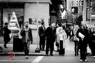 Post 939 12.17.11 An exercise in emulating the great street photographer Vivian Maier.. We were so privileged to see her exhibit in NYC yesterday..  FYI- The two people in the center who are looking up are my husband's cousin Nat and our own Smugmug Dailies Betsy Foster Breen ( she hasn't been on the Dailies for awhile) we met her in Manhattan yesterday and went to the Vivian Maier exhibit at The Howard Greenberg gallery together.