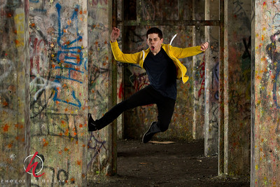 """Post 990 3.25.12 """"Matt Jumping"""".. Ha ha.. this was one of the most exciting shots that I have ever taken. We had our PhillySMUG meet for a practice shoot working on  Off-Camera Flash at the PHiladelphia Coal Piers... an abandoned area of urban decay with wonderful ever changing graffi and pillars and fallen chunks of rough cement and wood. Great, great location for photography. My co-leader Natasha and her husband Fred had an umbrella flash set up with some triggers and their friend, actor/model Matt was modeling mostly for their group..there were others of us shooting in different groups.. Anyway, Natasha and Fred were sharing their triggers for their flash and at one point they were working with Matt Jumping. I was trying to get him without the flash and just be quick.. ha ha..no way. the thrill of catching a shot like this when using the trigger was just awesome. I will have to practice this more. I do have a set of triggers, but hardly knew how to make good use of them. Learned a lot yesterday...now I have to put it into practice and use it so I don't forget.   Thanks for the comments on yesterday's centerpiece shot to those of you who saw it. I really was excited to see how it came out. So glad that I am shooting a little more again.. I sort of was in a dry spell and not shooting..Now I better get to my editing!!!   Happy Sunday all!!!"""