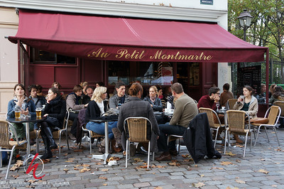 Post 996 3.31.12  Can your believe I am just finally sitting down to edit our photos from our 3 week trip to Europe last fall... My bad!!! This was in the Montmartre area near where my son was living...love those outdoor cafes.   Thank you for your comments on yesterday's shot from the White House Chef event.. especially your feedback on being offered food while shooting an event. In the future I will not be shy to make it part of  'the deal' when I commit to shoot an event. It was a long evening, especially with the smells of all that awesome food!!! ...ha ha, not that I need the calories, of course! :)