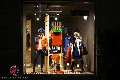 """Post 1006 5.4.12 A glimpse of Pisa, Italy at night!  I loved the colors of the fashions in this window display..they sure were aware that orange would be a big color for this season! I found it interesting that there were many windows that had some sort of message written and even though we were deep in Italy, the words were often in English.   Slowly I am attacking all my photos from our trip last fall to Europe. I just loved the beautiful windows along the way as we walked from our hotel the night we were in Pisa to see the leaning tower. I almost 'lost' these pictures.. Each night on the trip I would upload that day's pictures to my iPad as a back up.. good thing I did! When we got home I uploaded all the pictures, ( I thought ) to my computer.... I had almost 2000 pictures for 21 days.. I was sort of surprised it wasn't more, but didn't think much about it. I didn't really get back to editing more than a few images for a couple of months ( where does the time go?)  In the meantime I cleared and have used all those cards that I had from the trip.. Finally when I really sat down and studied what I had on the computer I realized I was missing 2 days of the trip which were our early morning train from Nice, France to Pisa, Italy that night and the next day in PIsa and our first night in Rome. I knew I had seen those pics.. My """"uh oh"""" turned to """"Oh Joy"""" when I remembered they were only on my iPad. It took awhile for me to finally sit down and figure out how to transfer them from the iPad to the mac, but finally last weekend I did!!!  Now I am happy to continue my processing. Whew, that was a close one!"""