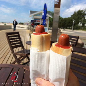 Daily Post 1162- 159/365   6/9/2014 - Hot Diggity Dog! Lunch at the beach front in Pärnu, Estonia. We had observed many people eating hot dogs like this over our travels here. Today we had our chance to try them! Tasty and easy to eat all wrapped up in their little bun!    We are loving this new town. Beautiful beach side community. Population of 44,000 and the main summer beach destination for Estonia! Most guests here other than Estonians are people from Finland. We lucked out finding a very nice hotel right on the beach and reasonably priced. Of course eating at seaside kiosks or mall restaurants also helps the travel budget!
