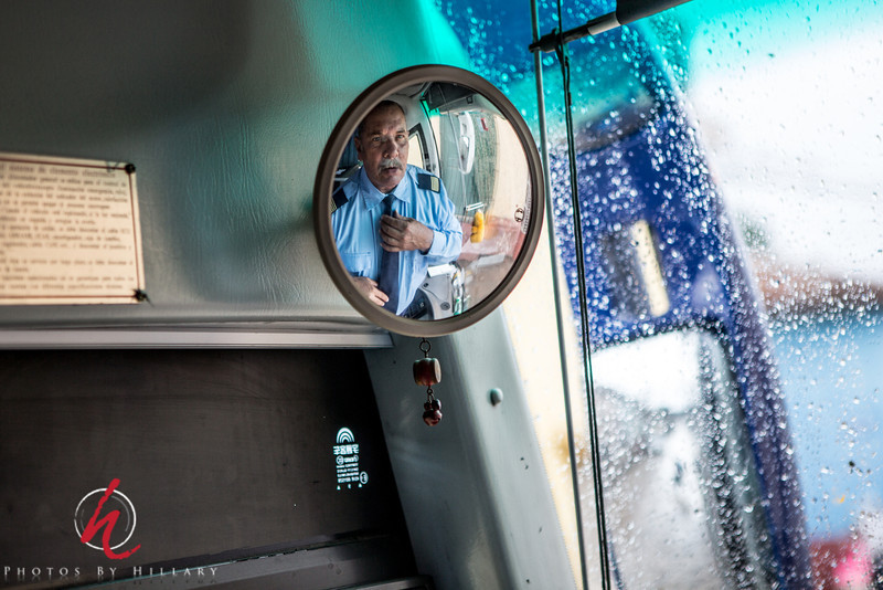 "<font size=""4""><b><font color=""Yellow"">Daily Post 1095- 60/365  3/01/2014 - Bus Driver spiffing up for the ride!   This was our bus driver for the bus trip from Trinidad, Cuba to Veradero on a VERY rainy day.. I was tickled to be able to photograph his reflection here in the mirror as he put on a fresh shirt and straightened his tie to get ready for the trip..  Thank you, thank you, thank you!!! What wonderful and very kind words by so many of you on my photo of Maria yesterday in her kitchen and really on all of my recent Cuba images. I really appreciate your supportive comments so much. I wanted to let you know what I found out about entering some of the people images to a competition I'm interested in entering. It turns out that I CAN enter without a 'model release' and  the photos will not be disqualified as what the administrators of the competition are concerned that in some countries there are laws regarding photographing people in public places..ie, France. But especially since this is for exposition and not commercial and Cuba and not some other countries they didn't think there was any conflict..sooooo, I guess I'll give it a try. I just have to give myself a kick to have the confidence to really do it. I'll keep you posted! Thank you for your encouragement..it truly is wonderful to receive your supportive thoughts!"