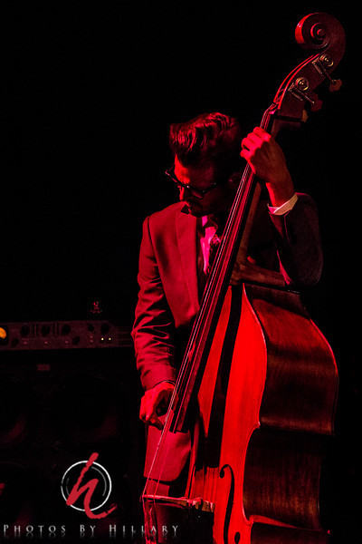 "Daily Post 1175 - 141/365   5/212014 - Jay Weaver on Bass… with The Mavericks.. at The Keswick Theater in Glenside, PA<br /> <br /> I met Jay a couple of years ago when he was backing up Raul on a solo tour. Very talented musician and such a nice guy. Loved the curves of the bass in this red light..one of the few shots I liked bathed in red! <br /> <br /> Judy (fotoeffects) …thank you for your thoughts on editing yesterday's  image of Raul to ""dodge"" the dark shaded by his hat to brighten up his eyes. I had tried that on a couple of images, but I was shooting at such a high ISO under these dark lights that there was very little detail to bring out and too grainy. Better to leave it dark and black…and keep him more mysterious. I will have more concerts to photograph this summer. I'm hopeful I'll have other opportunities for better photos. I appreciate your suggestion, though and thank you!"