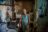 """<font size=""""4""""><b><font color=""""Yellow"""">Daily Post 1094- 59/365  2/28/2014 - Maria in Her Kitchen / Havana, Cuba  This photograph was from my first trip to Cuba November 2012. It was just by chance that we met this woman and then were invited in to see her apartment. It is my favorite image of all I took in the 2 trips. It was this photo that prompted me to describe the Cuban people as having a 'dignified poverty'. Her walls are peeling there are signs of wear and physical decay of her apartment throughout, but her apartment was neat, her bed footboard patched with cardboard…she maintained it as best she could. Maria was so very gracious to allow the other photographer I was with and me to photograph her. There was amazing light coming in over the divider that separated her kitchen here from her sleeping area which opened to a small balcony over the street. She had an amazing glow about her. As I walked out of there I was shaking..I felt this was my 'National Geographic' moment.. ha ha.. Very special to spend time with her. She was 76 years old and living alone in her small apartment.   I was able to see Maria again when we returned to Cuba last June. I brought her a copy of  this print and a couple of others of her. Incredible opportunity to find her and others that I had met and bring them back prints from the first trip. I will never forget my trips to Cuba…it really was an eyeopening experience about making the most out of what we have.   Thank you all again, for your very kind and supportive comments on these images. I have been doing a little research on the competition that I want to enter a series of Cuba images to, but my main concern is 'model' releases. I have no release from these Cuban people and no way of getting any so I wrote to ask what to do. Maybe some of the images where people are not so visible would be acceptable..I'll let you know if It looks like I have any chance of acceptance."""