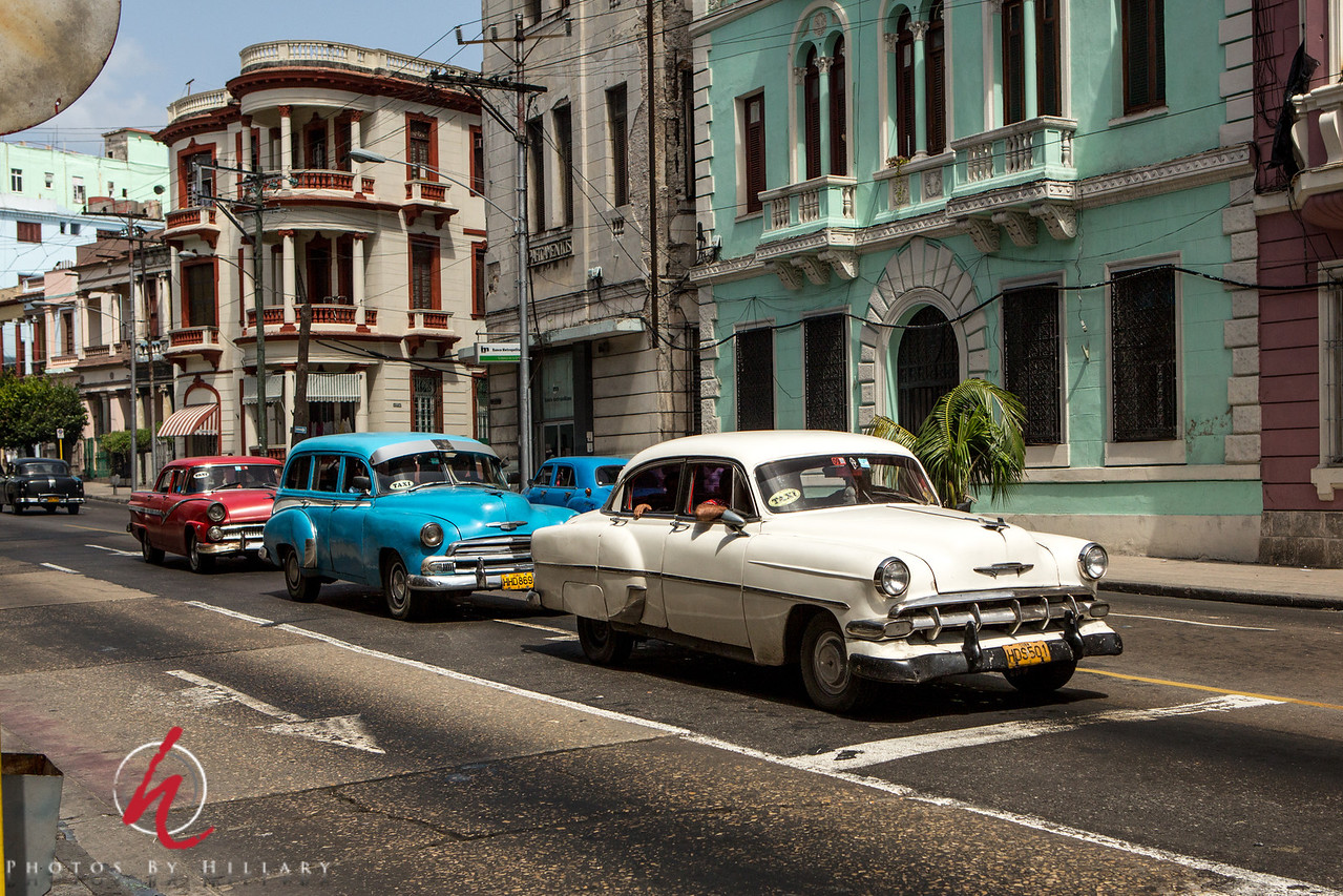 "<font size=""4""><b><font color=""Yellow"">Daily Post 1121-  87/365   3/28/2014 - Three Taxis - Here we have a parade of old cars used as taxis. Honestly, part of the time I was there I would just stand on the curb watching and photographing the cars as they passed. I was mesmerized to see them and hear them..the sound of these cars is not what we hear on the roads today.   I am really enjoying the comments on these photos of the cars as there are many of you who KNOW the makes and years…I have no clue, but I loved seeing them and so enjoyed the variety of colors they are painted along the way as well. They are amazing to see, that's for sure. However, if you don't know how to fix a car or have a friend who does you cannot own one of these as they all are in constant need of service. Many of the parts needed the Cubans make themselves or use parts from Chinese cars or tractors to help them continue to be roadworthy.   Have a wonderful weekend everyone!"