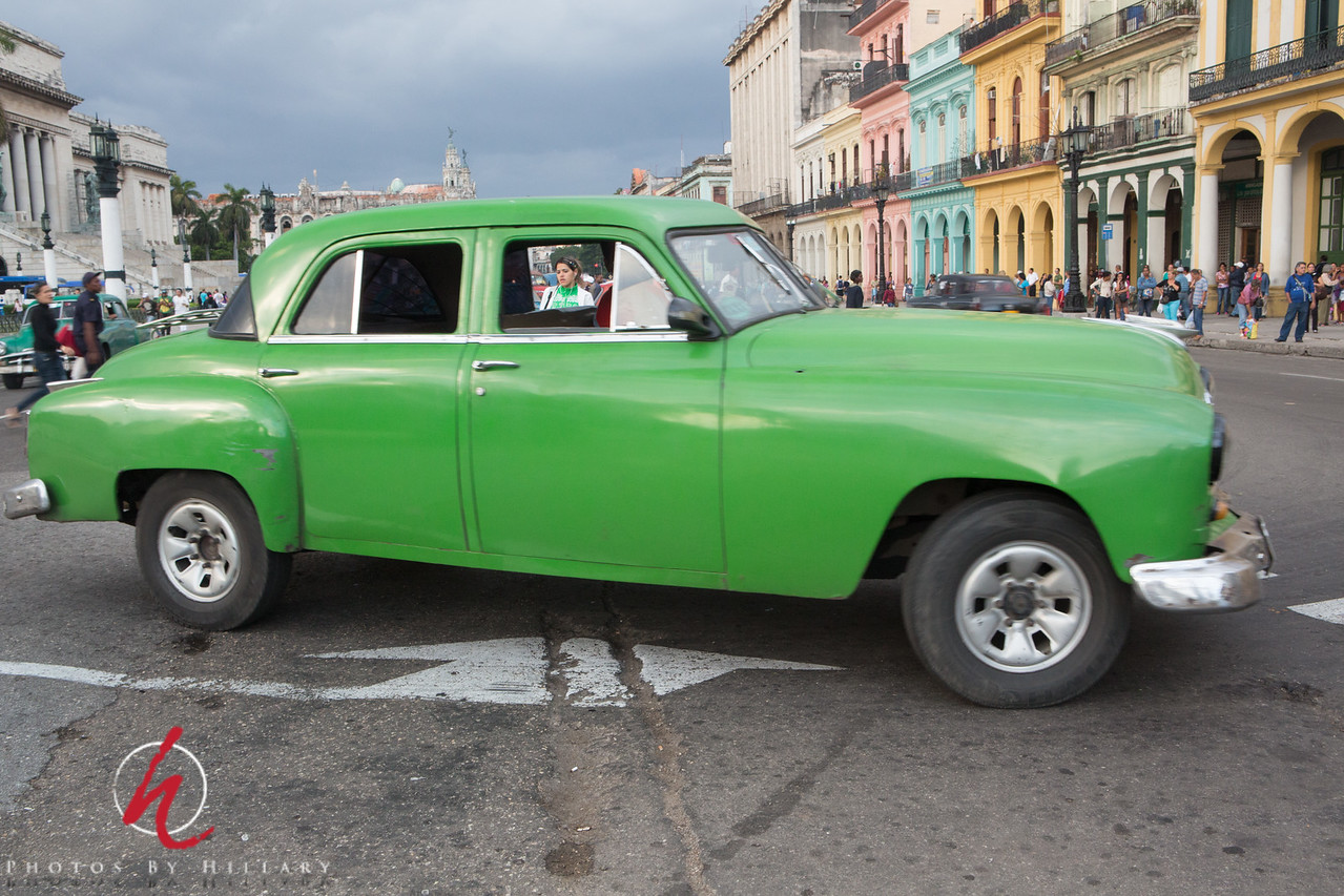 """<font size=""""4""""><b><font color=""""Yellow"""">Daily Post 1128-  94/365   4/4/2014 -Girl in Green Through the Green Window…  Here we are again in front of El Capitolio where there is a fascinating constant parade of the old cars. Just by chance I captured the young woman walking behind the car through the window.. I couldn't get enough of these.  Cold and gray outside in our neck of the woods, but a chance to catch up on some home chores for me! Hope you have a great weekend wherever you are! Thank you for your time and continued interest in these cars. Glad to have a place where they can be seen and shared. It was an amazing experience to travel to Cuba and we are still talking about it all the time."""