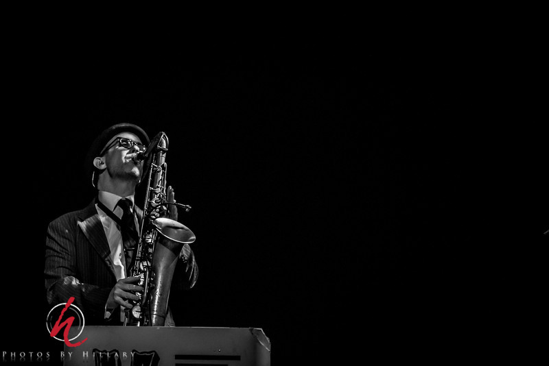 Daily Post 1178 - 144/365   5/24/2014 Max on Sax…again! <br /> <br /> I love the shadows and light playing across the image of Max in this photo.. Funny, it is so often hard to photograph the musicians at that back of the stage, but somehow there was some wonderful light on Max a number of times that night. <br /> <br /> Thank you all for putting up with me and all of these concert shots, I do love the challenge of expression, movement and low light. I so appreciate your comments. I have been very determined to keep up with the daily routine just for the discipline for myself this year…My husband and I  will be taking a trip to Eastern Europe leaving this coming Thursday so I may not be able to post daily while away, but will try and make up for every day I miss when I can. Also, I didn't want anyone to worry if after Thursday you don't see me post for a couple of weeks…..just in case!