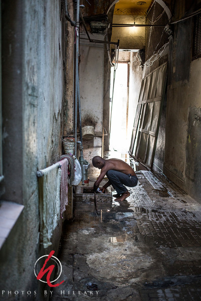 """<font size=""""3""""><font color=""""Yellow"""">Post 1041  6/365 1/6/2014 - A dark hallway in Havana, a man slowly fills his jug of water. June 2013  I had the wonderful opportunity to travel to Cuba twice in the last 14 months. I went November 2012 and then again June 2013. Both times with a photography group as a cultural/educational tour (legally licensed). It was an amazing experience. I was very fortunate and honored to be asked by our local Calumet Photographic store to put on an exhibit of my photos from the first trip. It was an honor I'll never forget. However, I picked out pictures for the exhibit and never really completed processing, organizing and editing the remainder my photos from that trip or the second trip that I took in June when my husband went along, too. Part of my focus in starting up with the dailies is not only to capture some new photos or join in on another Sunday night weekly photography challenge, but to work on my editing and processing of these photos and many others that have not been given the time and attention they need. I have other trips and many concert photos of Raul Malo and The Mavericks that I want to work on, so this will give me more purpose in getting that work done.  Thank you all again for this wonderful welcome back to The Dailies..Your comments on my photos and your warm welcome have really energized me and inspired me to keep up this daily routine. I see so many amazing photos when browsing and am totally in awe of the collective creativity and talent that you all show in this commuinty. I will mostly be able to browse and comment on my off work days… I look forward to seeing more of your wonderful images going forward!"""