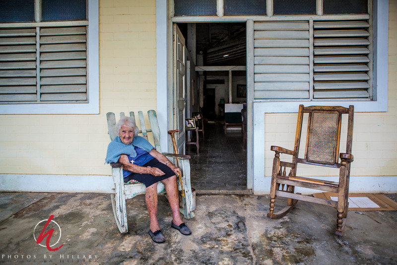 "<font size=""4""><b><font color=""Yellow"">Daily Post 1099- 64/365  3/05/2014 ""Tatica"" Viñales, Cuba…another quiet moment sitting on the porch watching the world go by. This lovely lady was 89 years old and had lived in this town her whole life.   I wish I had more words besides ""thank you"" for your wonderful enthusiasm for yesterday's street scene. Judy (fotoeffects)…thank you for your constructive criticism.. I did recrop a little when I got home tonight and you were so right about croping out those overhead power lines..that really did get out a distracting element and allow for more of a view of the street. I appreciate your thoughtful insights!  Thank you all!"