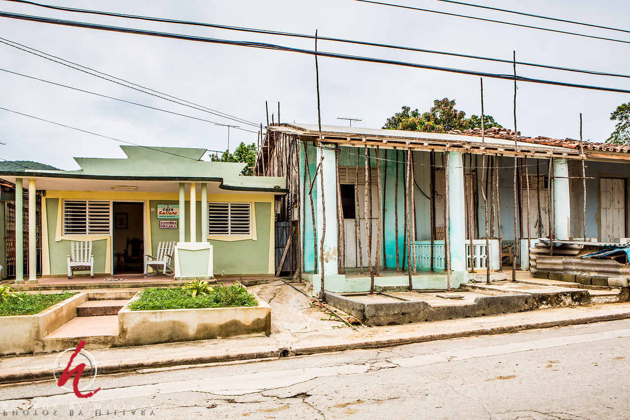 "<font size=""4""><b><font color=""Yellow"">Daily Post 1101- 66/365  3/07/2014 - A Casa Particular next to a rehab! Look at the ingenuity to use those poles to help support the roof as they do a restoration project on that old house. The green house with yellow trim is one of the many colorful houses up and down the streets where you can rent a room for the night. I took a lot of photos of the houses, but this one was an interesting one to share because of the work in progress next door.    Thank you all so much for your supportive comments on yesterday's photo of the familiy in their home while the dad rolled a cigar for us. Our trip had so many interesting 'moments' meeting people and getting glimpses of their lives. Thank you for sharing it with me!"