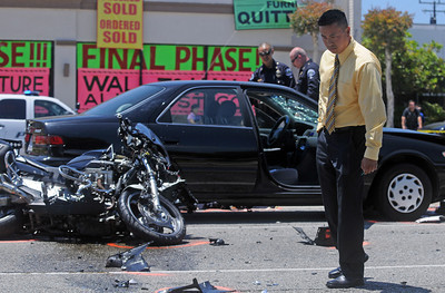 05-26-2011---Staff Photo by Sean Hiller--- Investigators work the accident scene where one motorcycle police officer was injured and another was killed on Hawthorne Boulevard in Torrance during a funeral procession for Manhattan Beach officer Mark Vasquez.