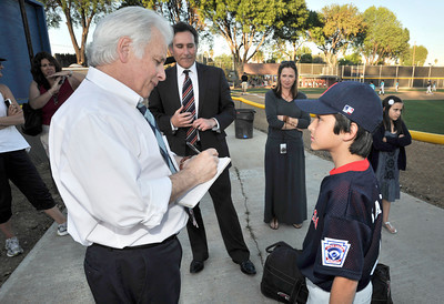 Dennis McCarthy interviews 10-year-old Logan Sabella. Logan and his parents started Love of the Game charity last season and raised more than $1,200 for the City of Hope. Woodland Hills, CA. 3-9-2011. (John McCoy/staff photographer)