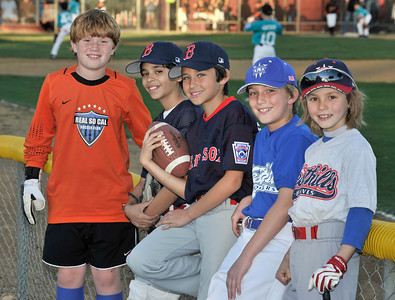 (l-r) Calvin Stephens,10, Noa McDowell,11, Logan Sabella,10, Justin Esters,9, and Liam Farrell,8. Logan and his parents started Love of the Game charity last season and raised more than $1,200 for the City of Hope. Woodland Hills, CA. 3-9-2011. (John McCoy/staff photographer)