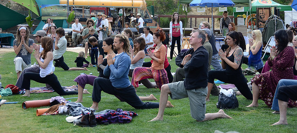People stretch out during the 12 annual Topanga Earth Day 2011 at the Topanga Community House Fair Grounds that runs over the weekend. Topanga CA. April 23,2011.  Photo by Gene Blevins/LA Daily News
