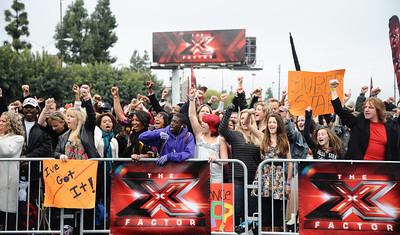 A estimated crowd of 15,000 plus started showing up as early as 4 am Sunday morning at the Los Angeles Memorial Sports Arena for the first auditions for the new Fox singing competition ÒThe X FactorÓ. Groups and singers as young as 12 years old audition for the series, which will premiere in the fall. Unlike ÒAmerican Idol,Ó ÒThe X FactorÓ does not have an upper age limit. Los Angeles CA. March 27,2011. Photo by Gene Blevins/LA Daily News
