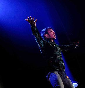 Lead singer Arnel Pineda of Journey performs to a crowd of 18,000 fans at the Hollywood bowl Tuesday night during their 2011 tour.  Hollywoood CA. Oct 11,2011. Photo by Gene Blevins/LA DailyNews
