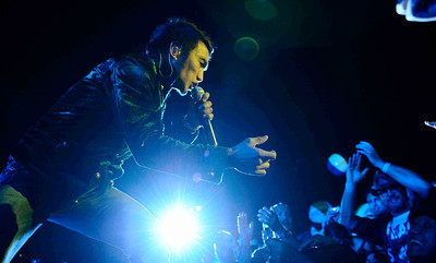 Lead singer Arnel Pineda of Journey performs at the Hollywood bowl Tuesday night during their 2011 tour.  Hollywoood CA. Oct 11,2011. Photo by Gene Blevins/LA DailyNews