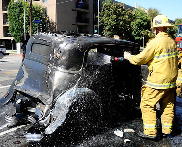 LA city firefighters and tow truck crews work on trying to get out a cement truck that was backing up a ramp and fell through to the bottom of a warehouse after the ramp gave way on the 1200 blk of Palmetto st. The driver suffered minor injuries from the crash and crews will have to pull the cement truck down to get it out of the warehouse. Los Angeles CA. Aug 19,2010.Photo by Gene Blevins/LA Dailynews