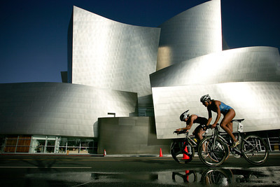 LA TRIATHLON--Pro racers Emma Showsill, #26 and Julie Dibens, #27, race neck to neck past the Disney Concert hall in Downtown Los Angeles sunday during the 2007 Los Angeles Triathlon.  Former race champion Snowsill went on to win the women's race  Photo by David Crane/Staff Photographer.