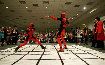 Malek Fernandez of La Habra and Scott Coen of Moorpark battle during a game of human chess. Fernandez and Coen are dressed as Deadpool, a Marvel Comics character. The 2011 Anime Expo kicked off at the Los Angeles Convention Center in Los Angeles, Calif. on Friday, July 1, 2011. The four-day convention is the largest in the U.S., drawing tens of thousands, and is organized by the Society for the Promotion of Japanese Animation (SPJA).  (Maya Sugarman/Staff Photographer)