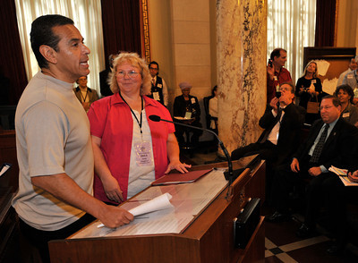 Mayor Antonio Villaraigosa is joined by Neighborhood Council Chair Cindy Cleghorn as he addresses a packed City Hall Council Chambers that is filled with Neighborhood Council leaders from throughout the city. The leaders have partnered with the Department of Neighborhood Empowerment (DONE) in bringing the 2011 LA Congress of Neighborhoods to City Hall. Los Angeles, CA 9/24/2011(John McCoy/Staff Photographer)