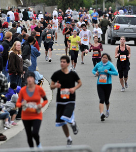 Runners near the finish line at Parkheath Dr. and Argos Street. A record turnout of more than 7,000 runners was estimated to participate in the 26th annual Dole Great Race of Agoura Hills, a nationally recognized running event bringing running enthusiasts of all levels from around the world to the city of Agoura Hills CA. 3-26-2011. (John McCoy/staff photographer)