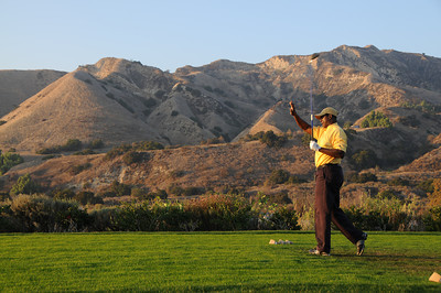 Dwight Hicks drives his ball off the 17th tee box at Angeles National Golf Course where the mountains and the wash join the links on the northmost part of the golf course. The City Council today approved a long-awaited historic transfer of nearly 280 acres of open space from the Angeles National Golf Club to the Mountains Recreation and Conservation Authority (MRCA), elating the community that has worked for 15 years to ensure completion of the arrangement. Tujunga, CA. 11/16/2011(John McCoy/Staff Photographer)