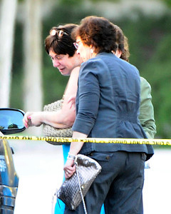 (C) The woman who is believed to be the wife who found the bodies of her husband and her parents is comfort by friends at the scene 23803 Bayview Ct. were 3 adult  were found inside a car from gun shot wounds this afternoon in Valencia CA. Aug 5,2011 photo by Gene Blevins/LA DAILY NEWS