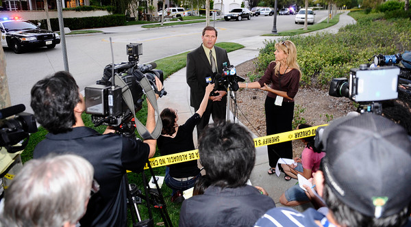 LA county Lt. sheriff John Corina of homicide bureua updates the media the scene at 23803 Bayview Ct. were 3 adult bodies were found shot inside a car this afternoon in Valencia CA. Aug 5,2011 photo by Gene Blevins/LA DAILY NEWS