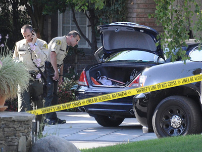 LA county sheriff on the scene at 23803 Bayview Ct. were 3 adult bodies were found inside a car this afternoon in Valencia CA. Aug 5,2011 photo by Gene Blevins/LA DAILY NEWS
