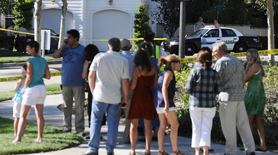 Local neighbors watch LA county sheriff at 23803 Bayview Ct. were 3 adult bodies were found inside a car this afternoon in Valencia CA. Aug 5,2011 photo by Gene Blevins/LA DAILY NEWS