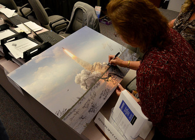 Twenty year long NASA worker Gail Villanueva signs a shuttle photo  with only 3 days left of the last space shuttle launch of Atlantis that is set for July 8th at Kennedy Space Center. FL. July 5,2011. Photo by Gene Blevins/LA Daily News