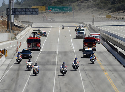 CHP and LA city fire trucks make there way south bound on the 405 as work crews finish 17 hours ahead of schedule as the 405 freeway was reopen  around 11:30am this morning.   Los Angeles CA  July 17,2011. Photo by Gene Blevins/LA Daily News