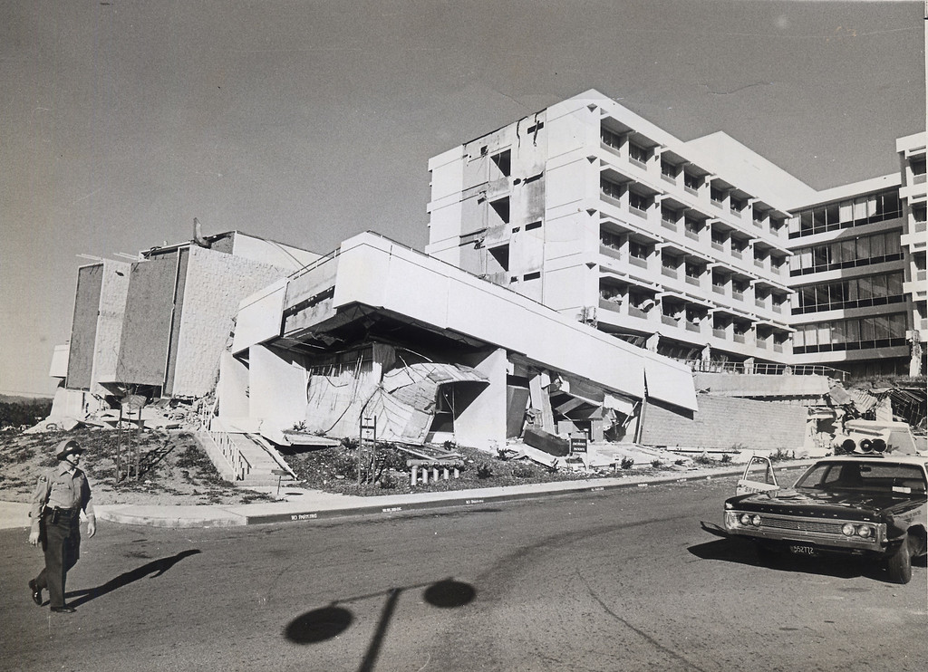 . The 1971 San Fernando earthquake (also known as Sylmar earthquake) struck the San Fernando Valley near Sylmar at 6:00:55 a.m. PST on February 9, 1971, with a magnitude of 6.6.  A sheriff deputy outside the collapsed Olive View Hospital following the quake.  There are various names for this earthquake. Seismologists call it the San Fernando earthquake. USGS \'Sylmar Quake\' or \'Sylmar earthquake\' is the name initially given to the event by local media outlets, because the worst damage was to the Olive View Medical Center, located in Sylmar. Local veterans of \'the Sylmar Quake\' commonly refer to this seismic event as the \'February Ninth\' quake. (Daily News File Photos.)