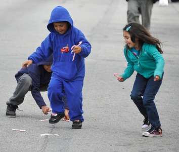 Kids run to pick up candy during the 43rd Annual Pacoima Christmas Parade and Festival. Dec 4 ,2010. Photo by Gene Blevins/LA Daily News