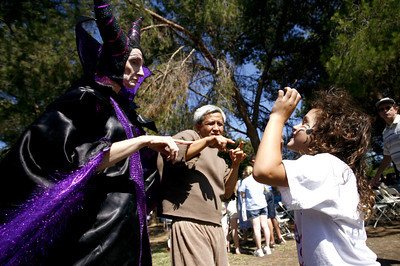 5-year-old  Rose Crisman from Pasadena, signs remarks to the wicked witch character during the 4th Annual Deafest held at Woodley Park in Van Nuys, CA. September 16, 2007. (Ernesto Elizarraraz, Special to the Daily news)